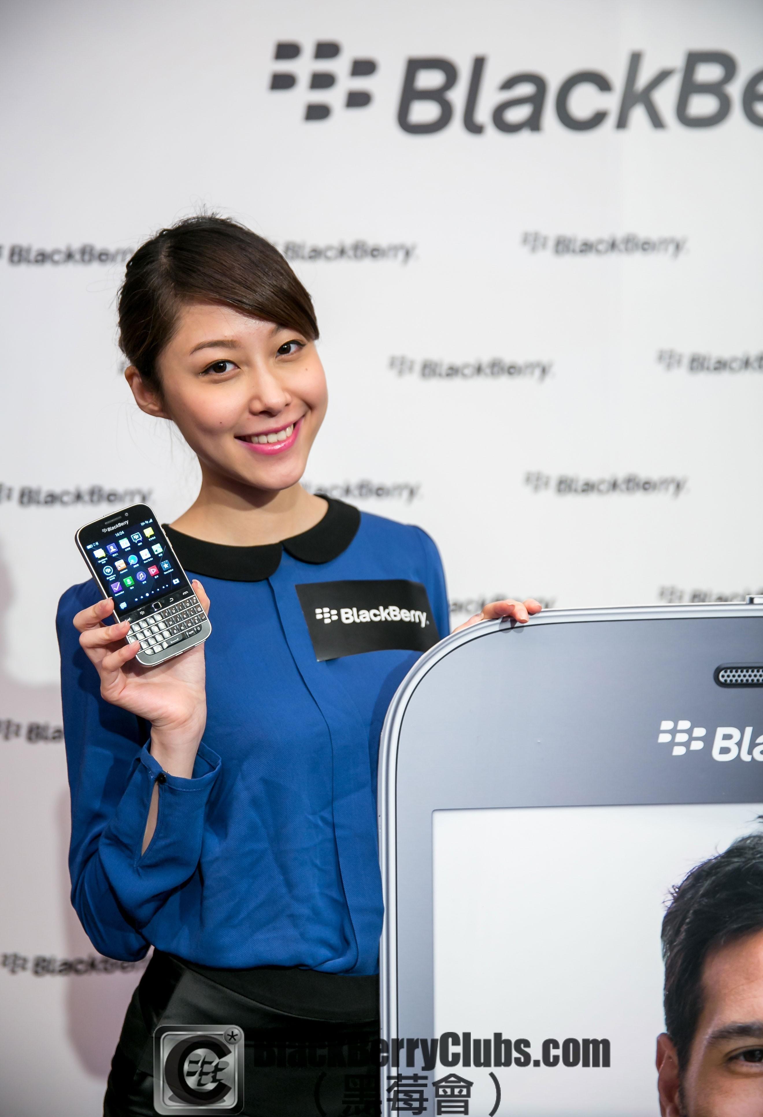Female model holding BlackBerry Classic